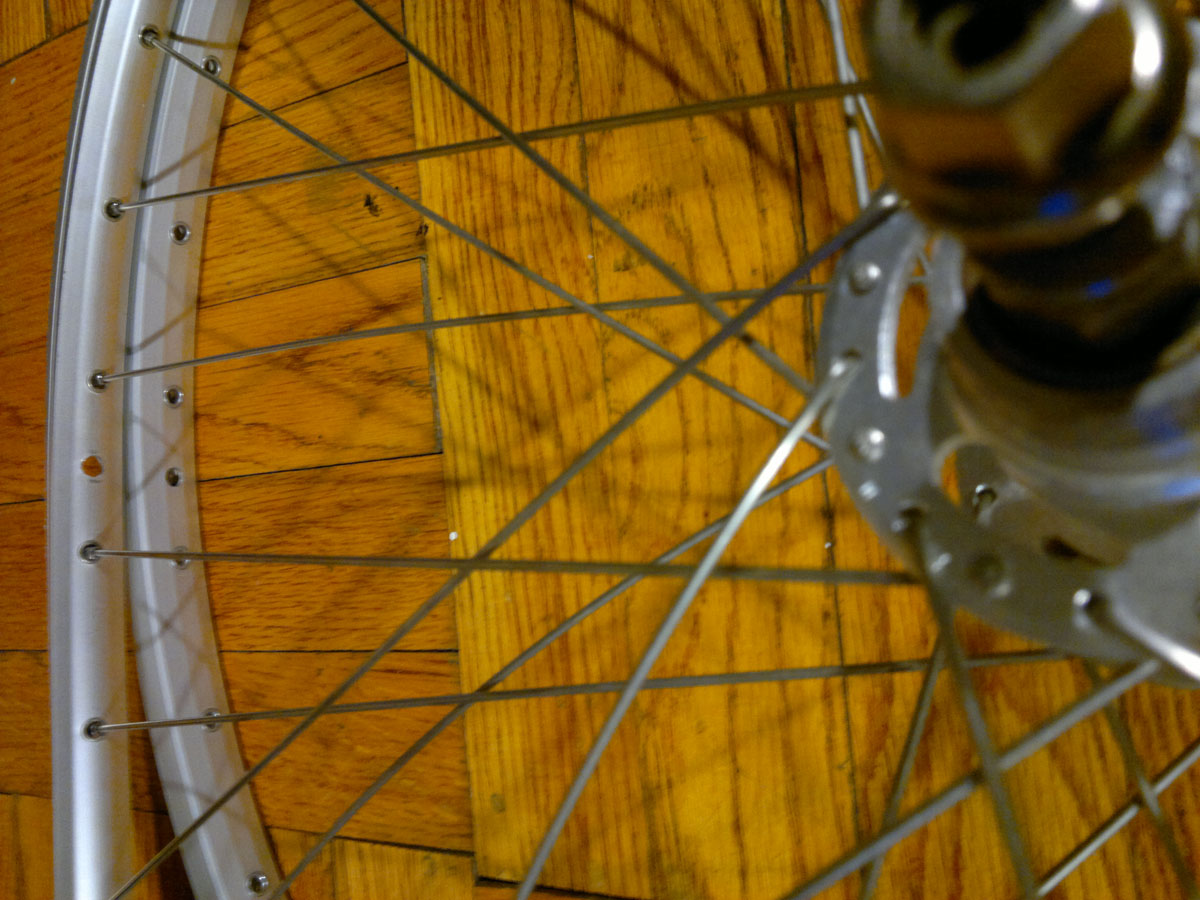 Watch video for Step 4) Transfer a spoke from the existing wheel to the new rim.