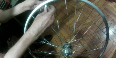 Watch video of Step 6) Tighen each nipple a set amount. Go around the wheel several times.