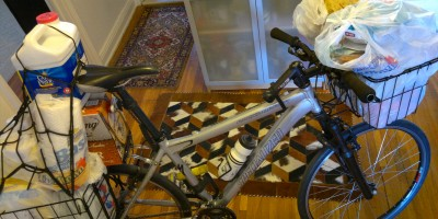 photograph of -this-really-should-not-be-in-the-house--bicycle-loaded-with-groceries-full-bMHR
