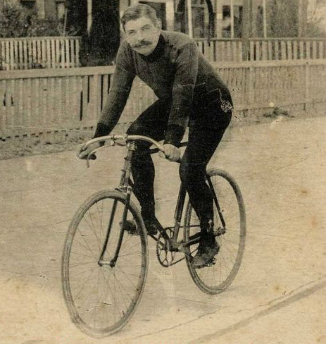 The inspiration is: Urbane urban rider of the late 1800s on a safety bicycle image