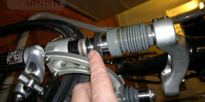 Opening up the Rock Shox FSX for teardown disassemble interior inner parts in the bicycle workshop.