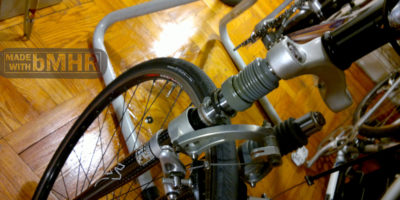 phot of Opening up the Rock Shox FSX for teardown disassemble interior inner parts in the bicycle workshop.